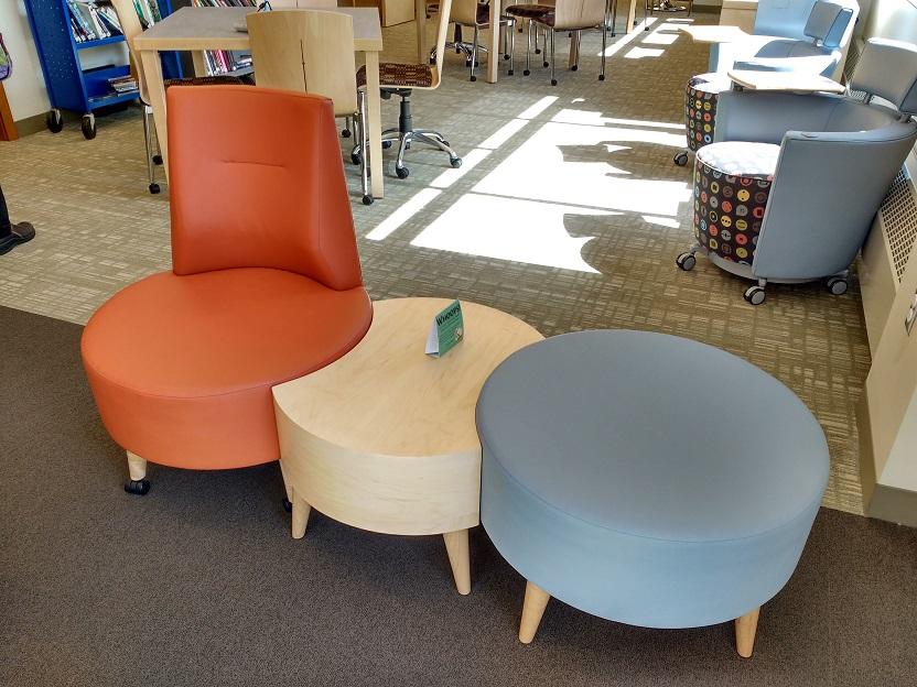 modular furniture that connects - a chair attached to a circular table attached to a circular cushion
