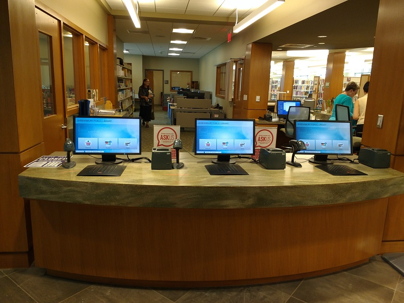 self checkout computers and equipment at the front circulation desk